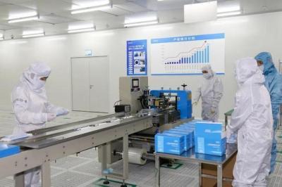 欧菲医疗用品公司正式投产 日产口罩百万只